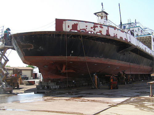 Rusty ship on land
