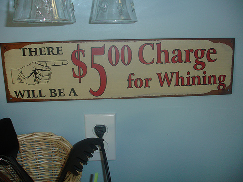 5$ charge for whining sign