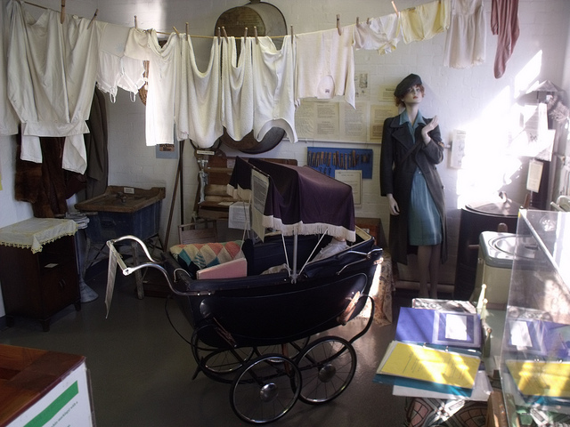 Room with pram and clothing line